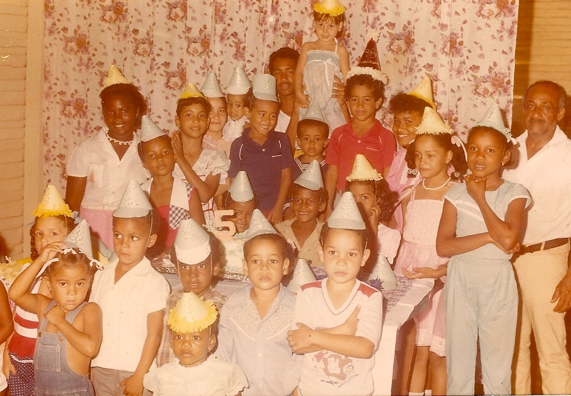 My grandfather is to the far right. I'm in the middle, in blue, next to Yvan, with the navy blue shirt.