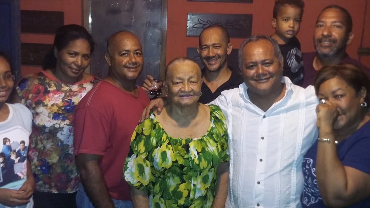 My grandmother's 81st birthday. She's surrounded by some of her sons and other family members. This photo was taken in 2018 in Sosúa.