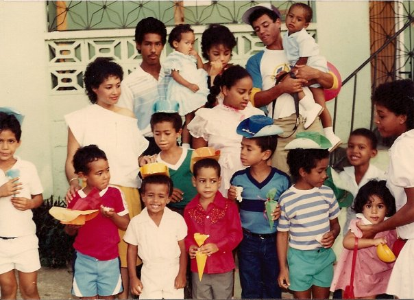 Here we are at a birthday party with our family, most likely looking at what each other got. Yiyo is in the middle, wearing blue, and I'm in red, to the left, with my hat on hand.