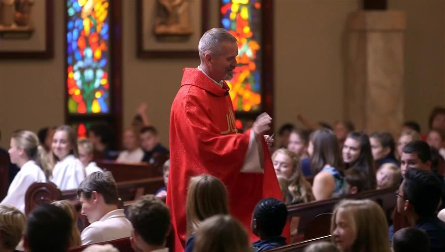 Fr. Eric with kids at mass