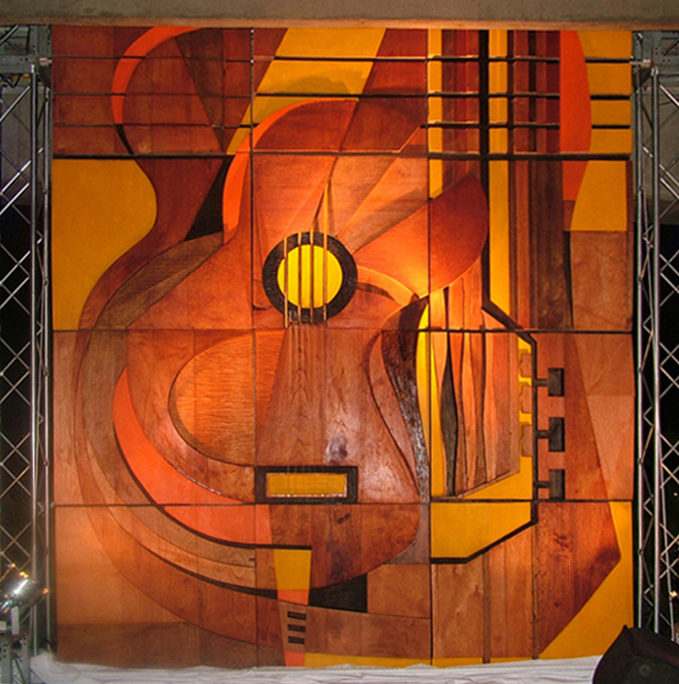 Retrato de cuerda ,  Bajo relieve sobre madera de cedro, 2008. Mural para Juan Luis Guerra.