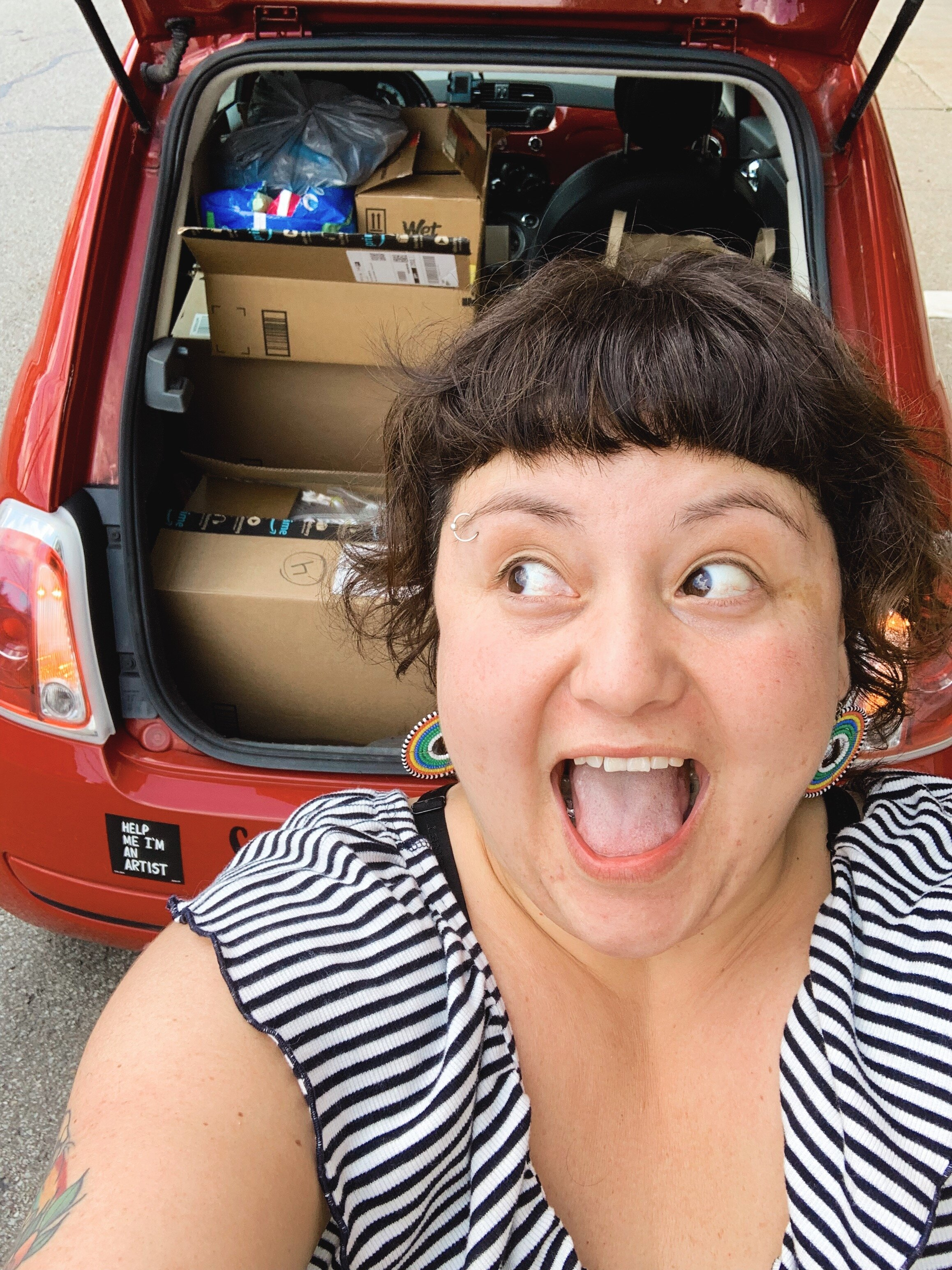 Founder Sandra, with a car fully packed from donations at Hippie & French