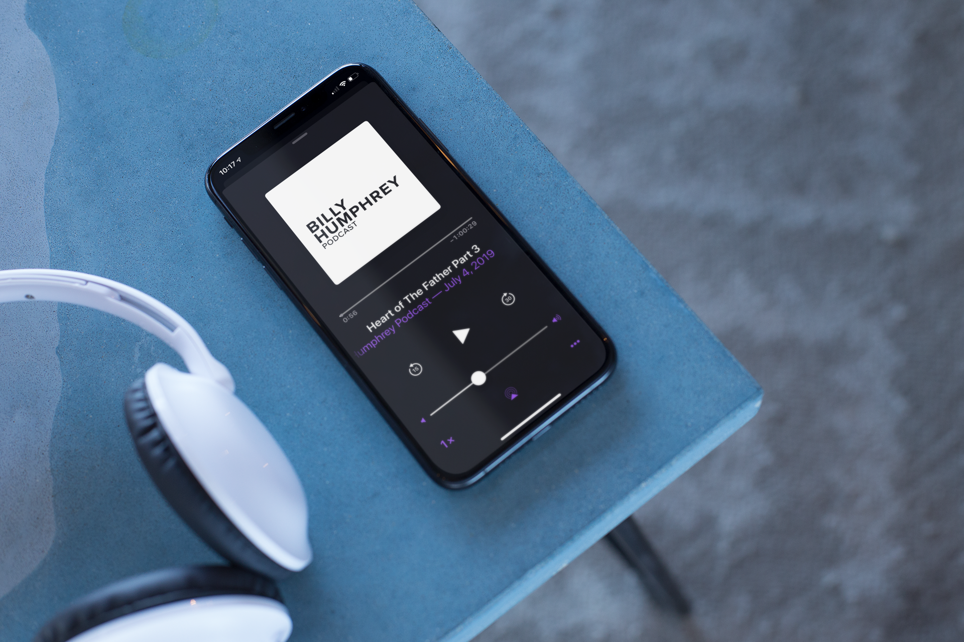 podcast-mockup-featuring-an-iphone-x-on-a-table-24795.png
