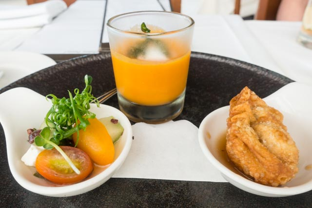 MW Restaurant's Prix Fixe Lunch Appetizer Trio: Chilled Tomato Soup, Ahi Poke Mandoo, and Greek Salad with an Asian Twist