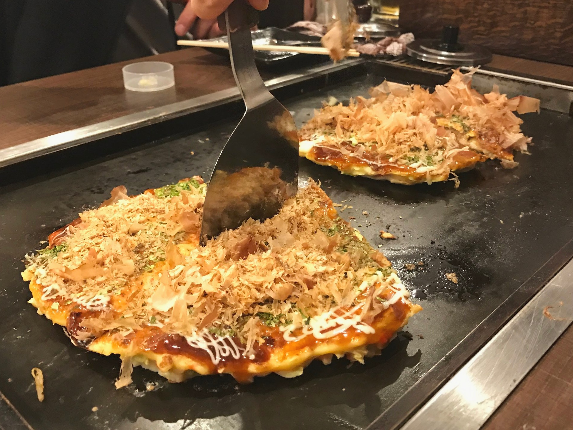Cook Your Own Okonomiyaki - Cutting and Serving Okonomiyaki
