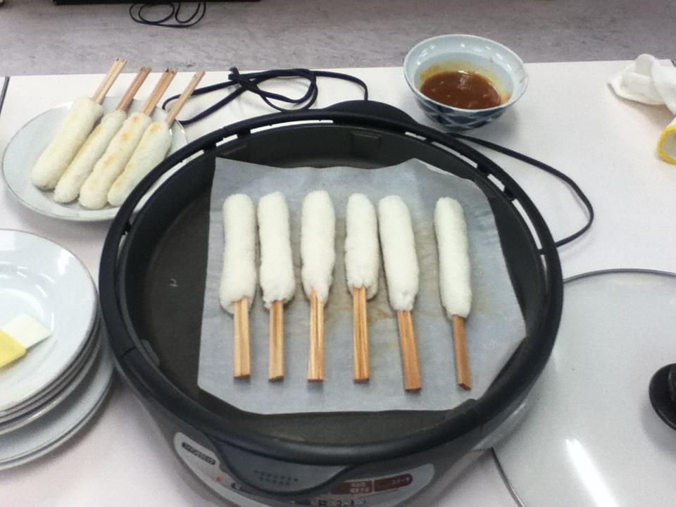 Kiritanpo: Akita's Specialty Dish - Grilling the Kiritanpo