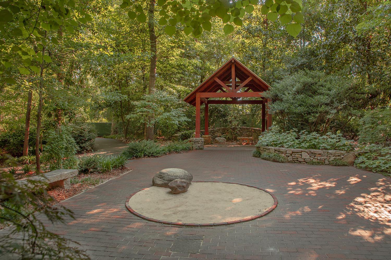 Garden of Hopeand Healing - A harmonious event backdrop with an arbor, sand garden, and pavilion.