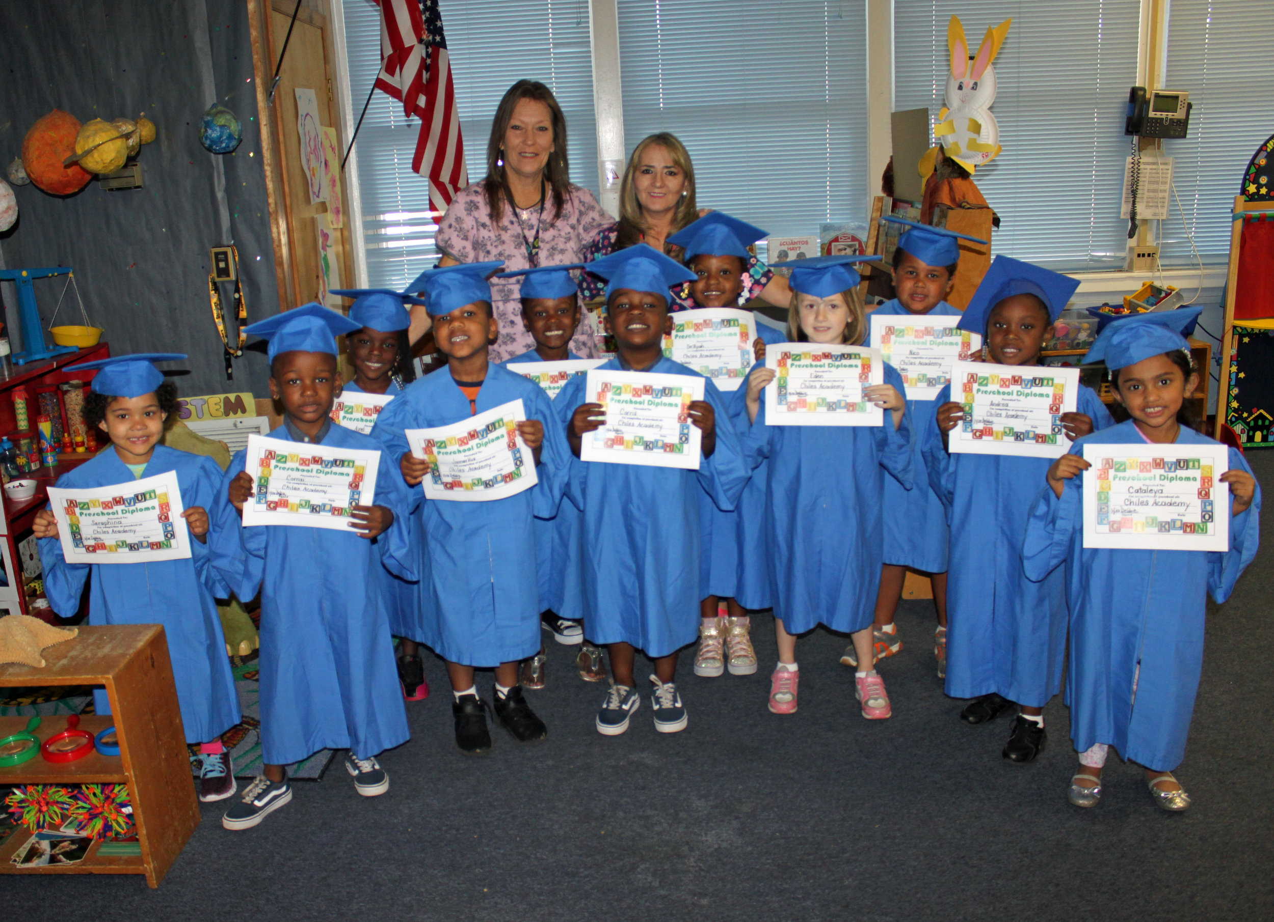 Ms. Debbie and Ms. Rosario with their youngest graduates—ready for Kindergarten!