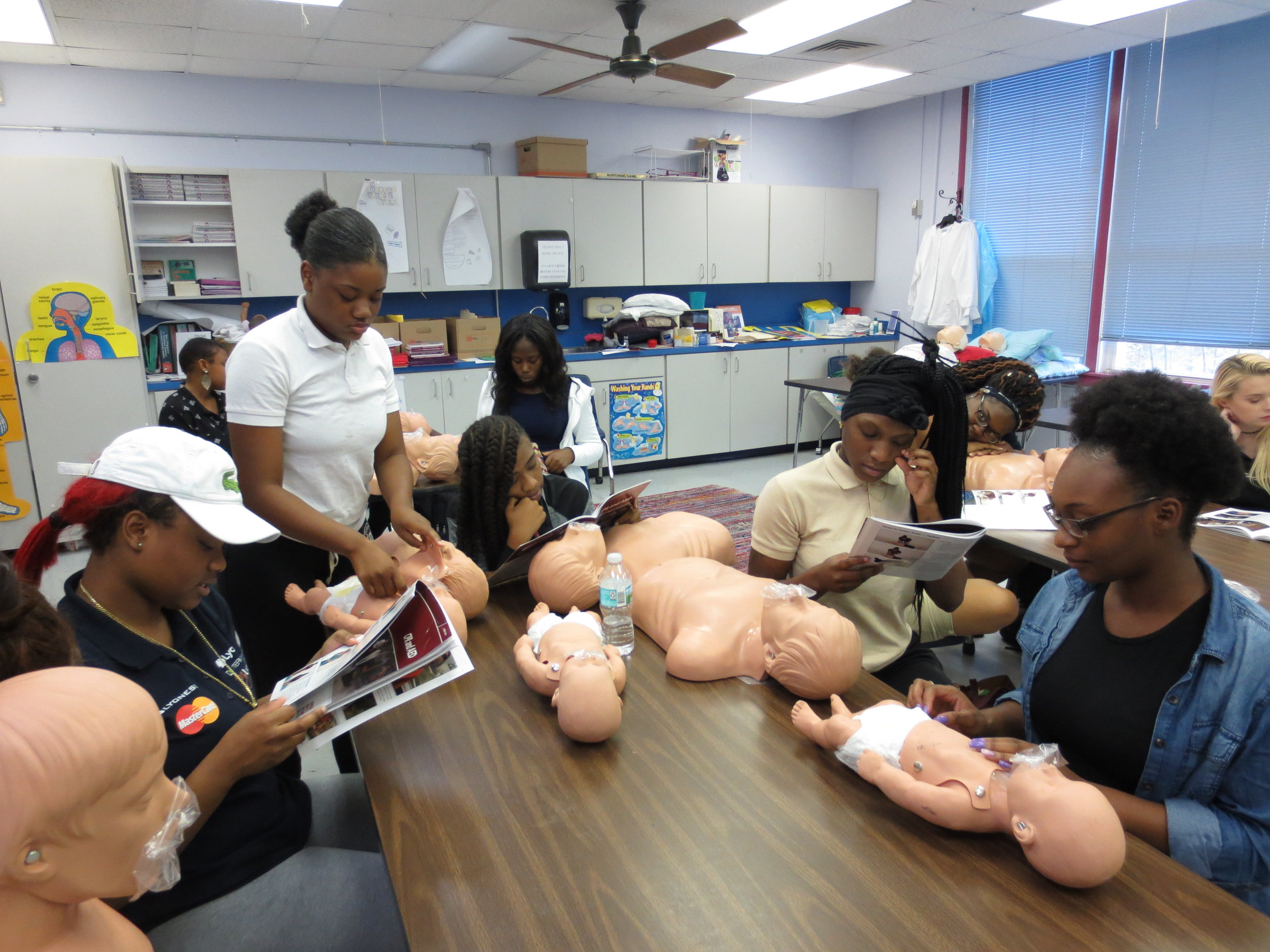 Students learn infant CPR for certification in the Health Care track of Career Connections