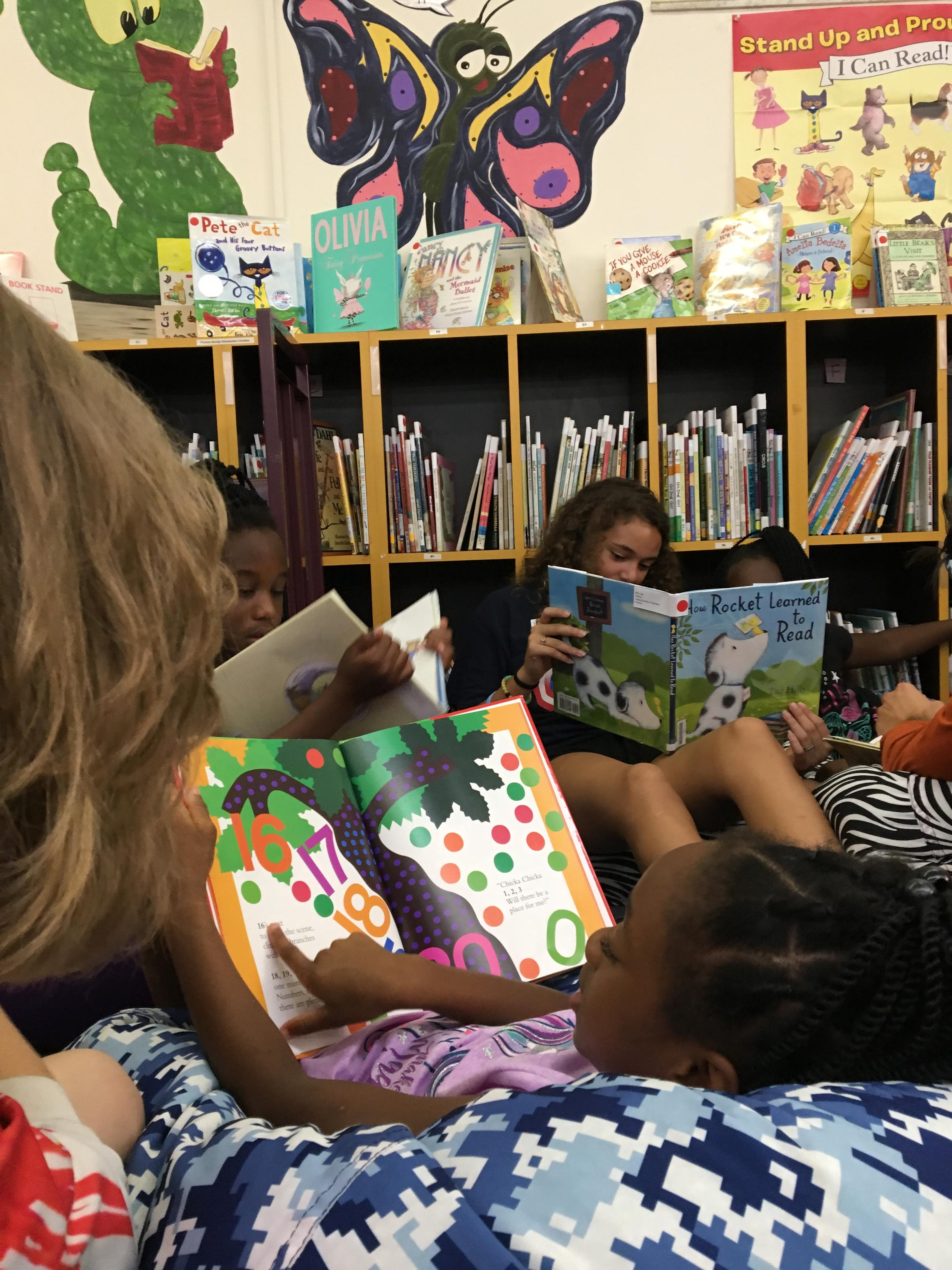 Students from the Summer Reading Program work with volunteer Reading Mentors to promote early literacy.