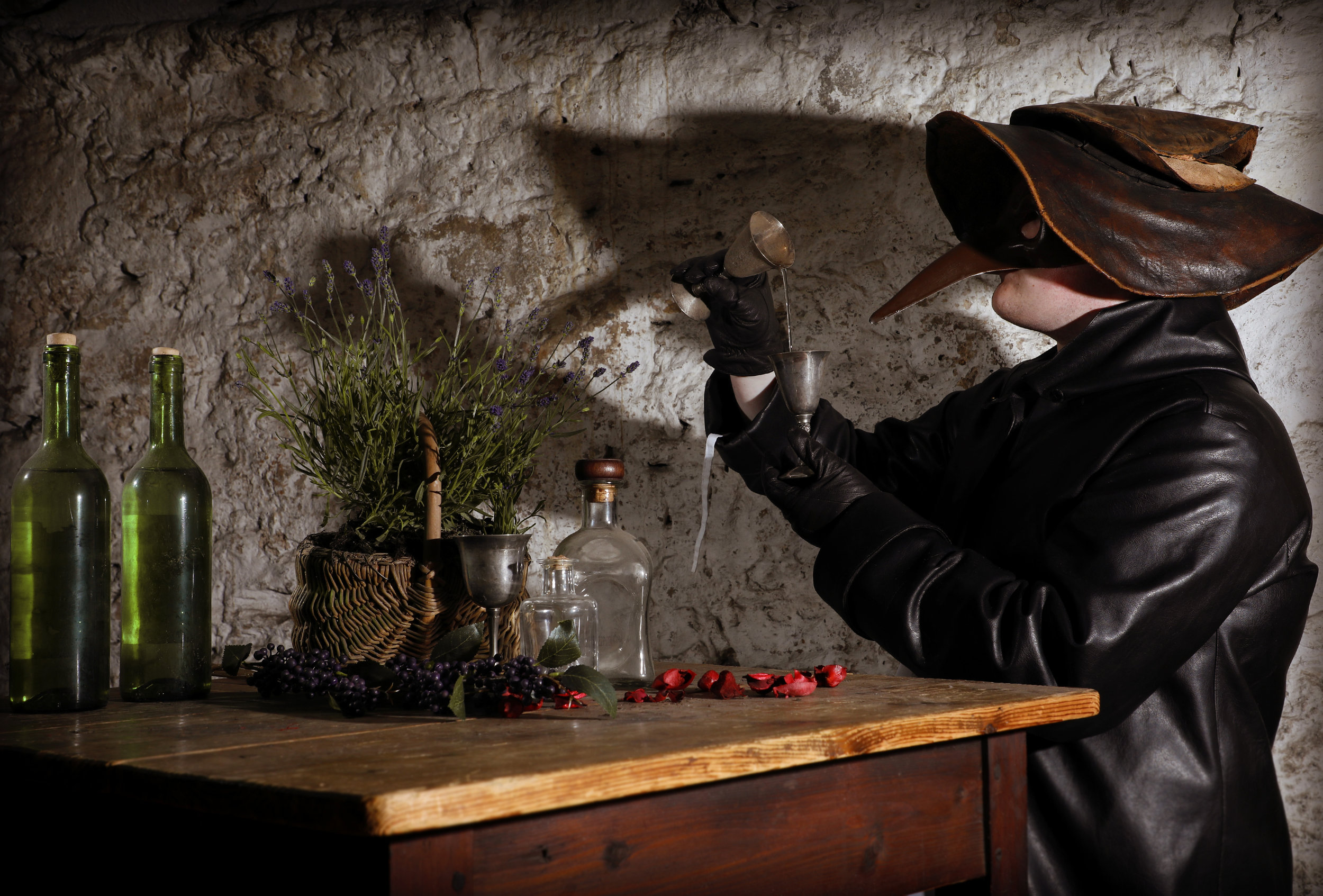 The-Real-Mary-Kings-Close-Old-Curiosity-Gin-tour_-Plague-Doctor-Mask-with-making-gin.jpg