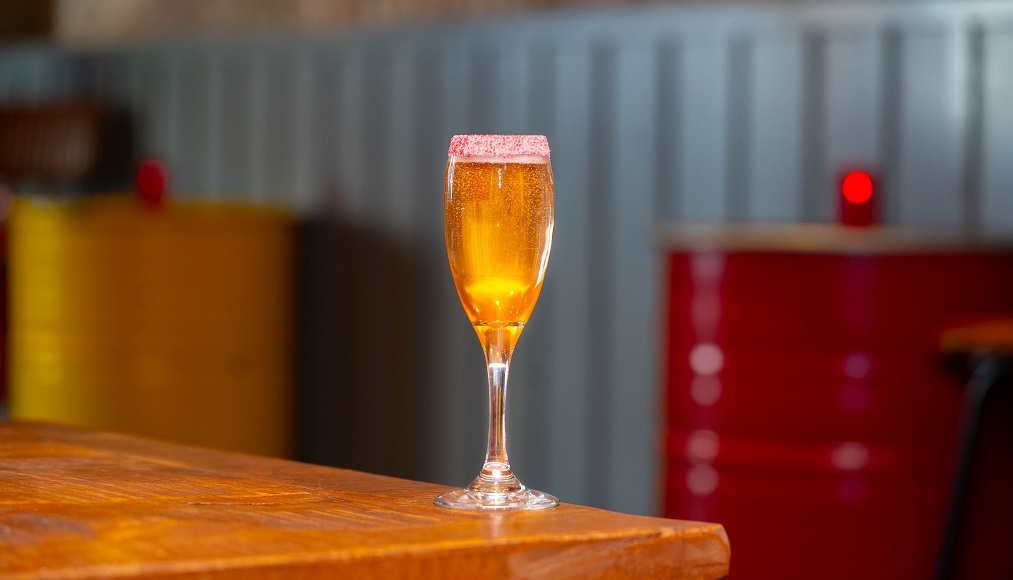 STRAWBERRY LETTER : Ketel One Vodka and Strawberry Shrub, topped with Prosecco
