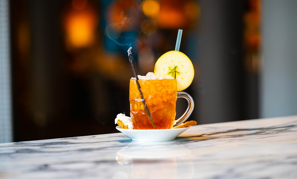 ĀBOLU PĪRĀGS : Sailor Jerry Rum, Cinnamon Syrup, Apple Juice and Lime Juice, topped with Soda Water and a side of Whipped Cream