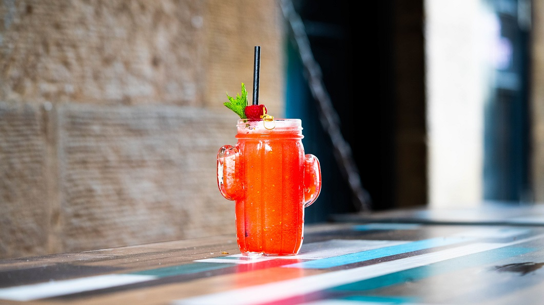 CISCO KID : Jalapeño-Infused El Jimador Tequila, Fresh Lemon Juice, Raspberry-Infused Agave Syrup, topped with Corona, served frozen