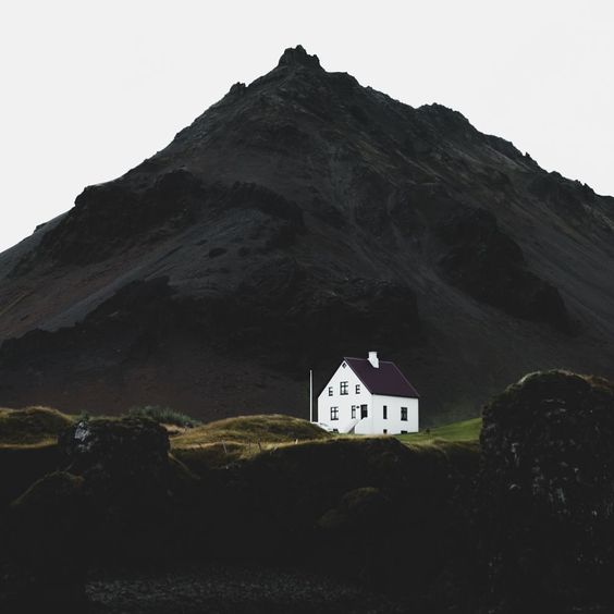 Sustainability article. Image of Norwegian countryside scene with white house