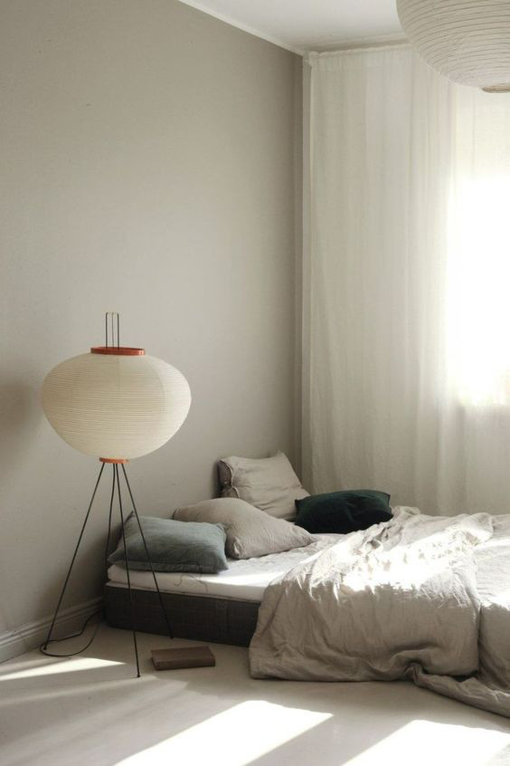 Rented Apartment article. Image of beautiful light fitting next to a bed.jpg