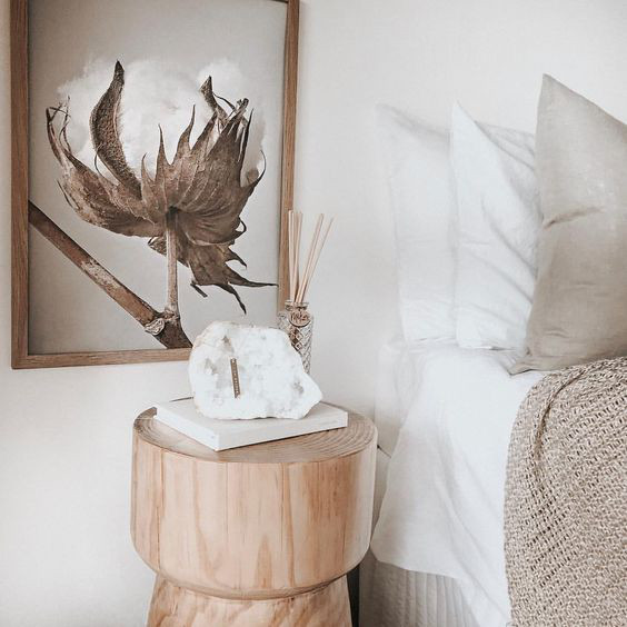 Cosy minimalism article. Image of bedside table and blankets in different textures.jpg