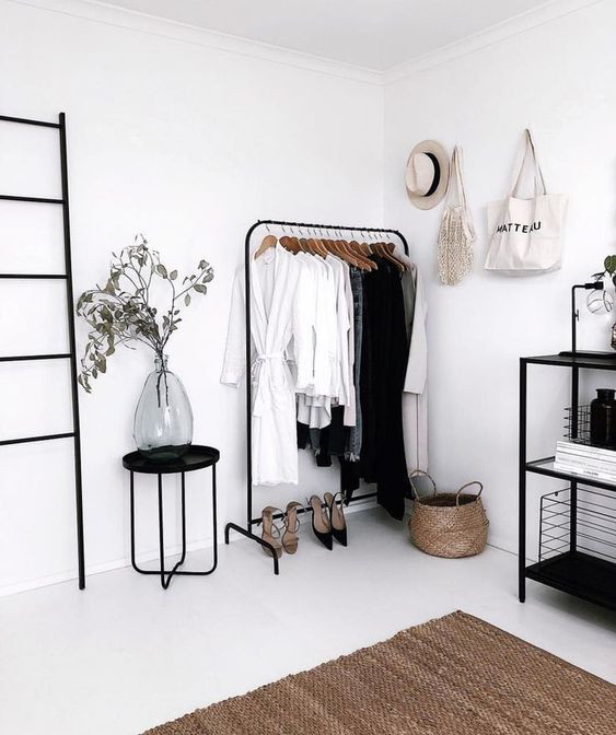 The Ultimate Decluttering Guide article. Image of minimalist storage in bedroom.jpg