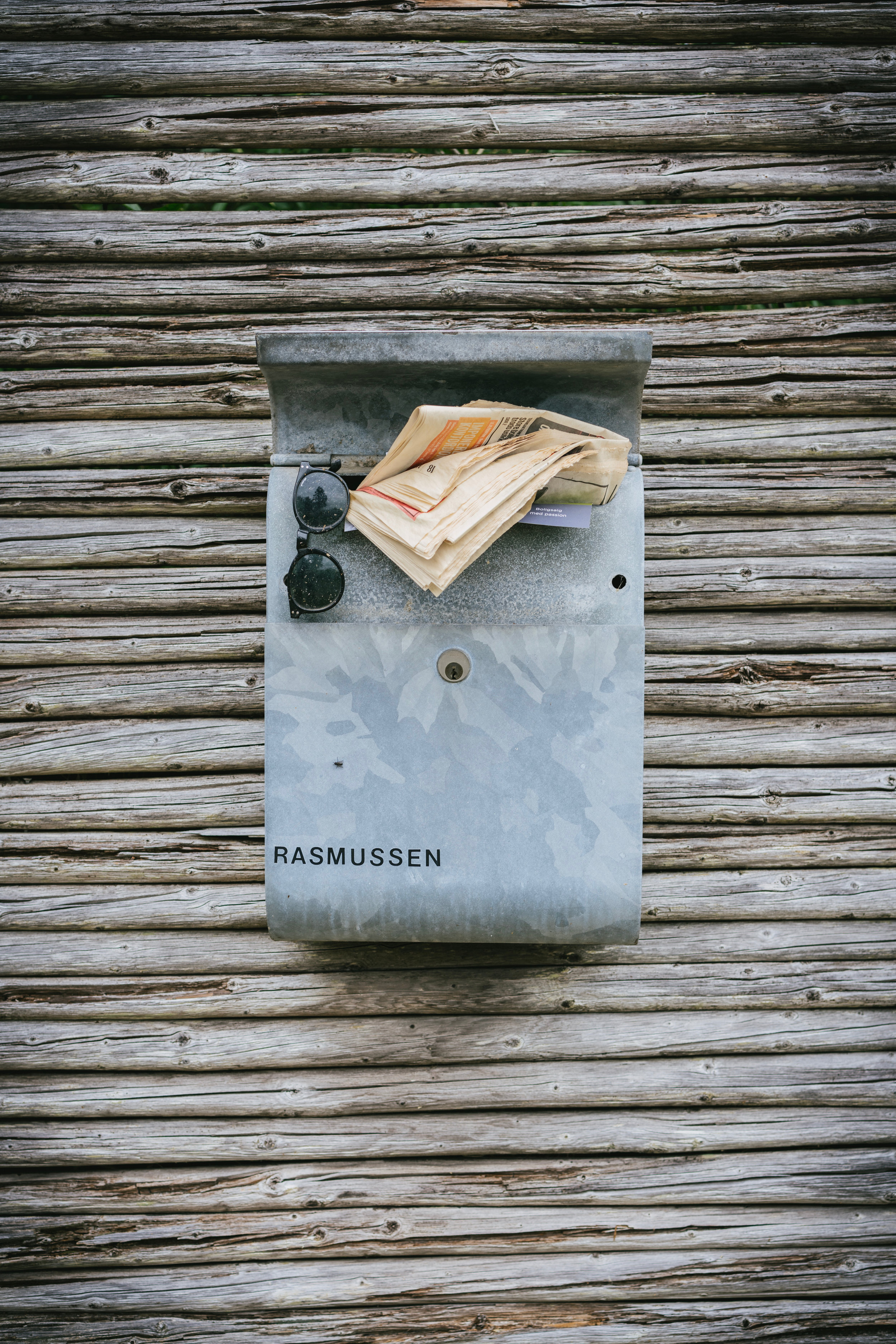 10 Facts About Denmark article. Image of rustic postbox with family name on it.jpg