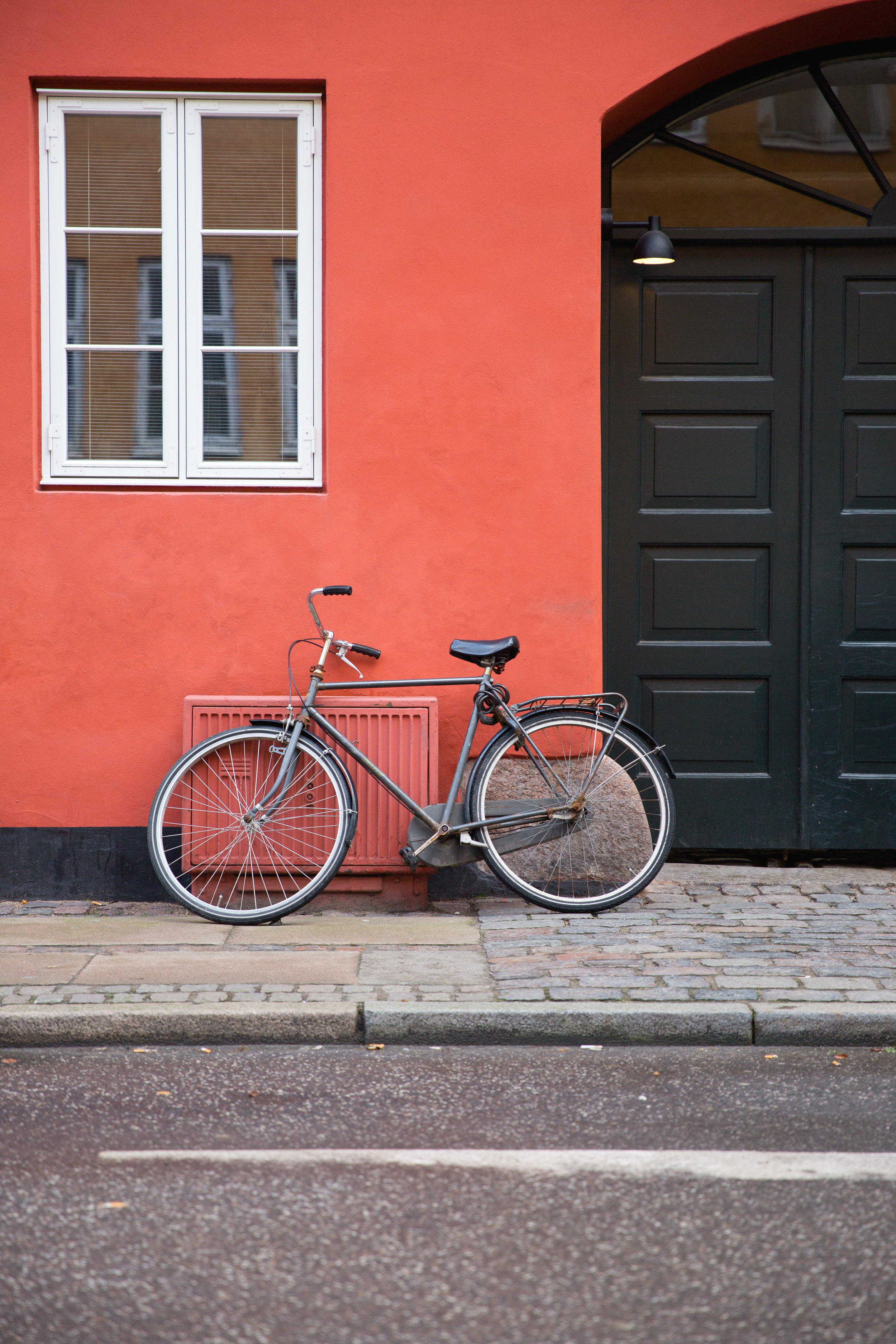 10 Facts About Denmark article. Image of bike leant against a building in Copenhagen.jpg