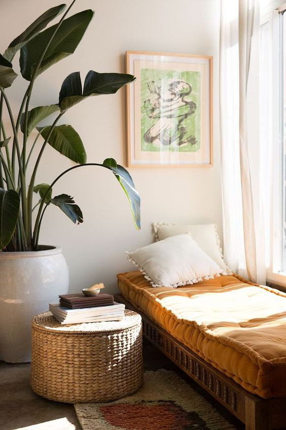 Cosy room article. Image of plants next to a day bed.jpg