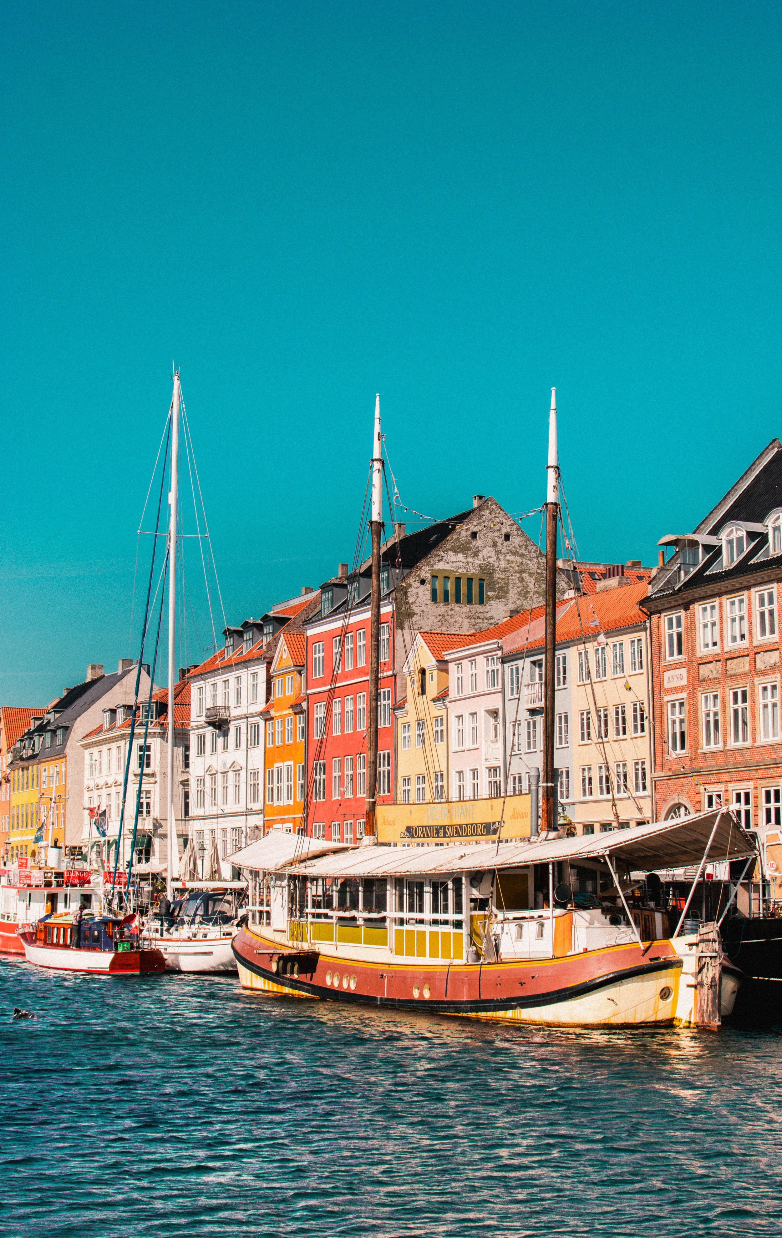 Eco Travel Guide to Copenhagen article. Image of boat docked at Nyhavn.jpg