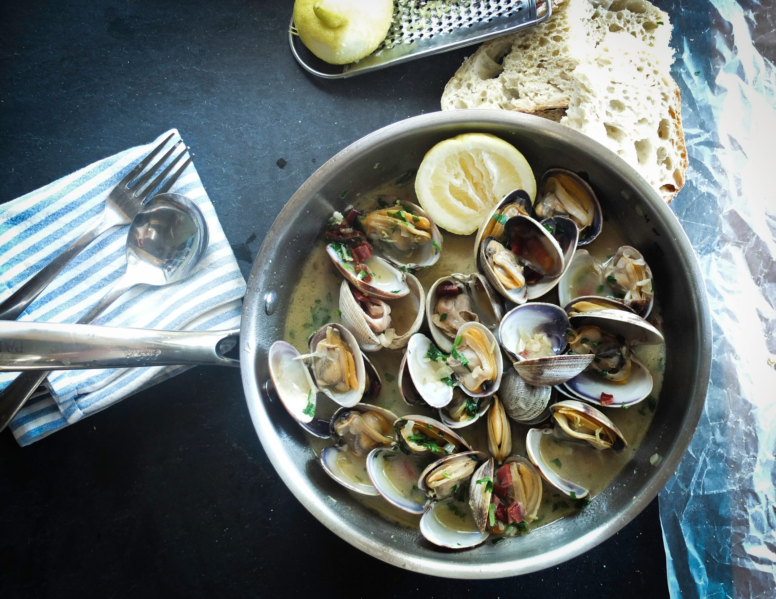 Foods that will save the planet article. Image of mussels cooked in a pan.jpg