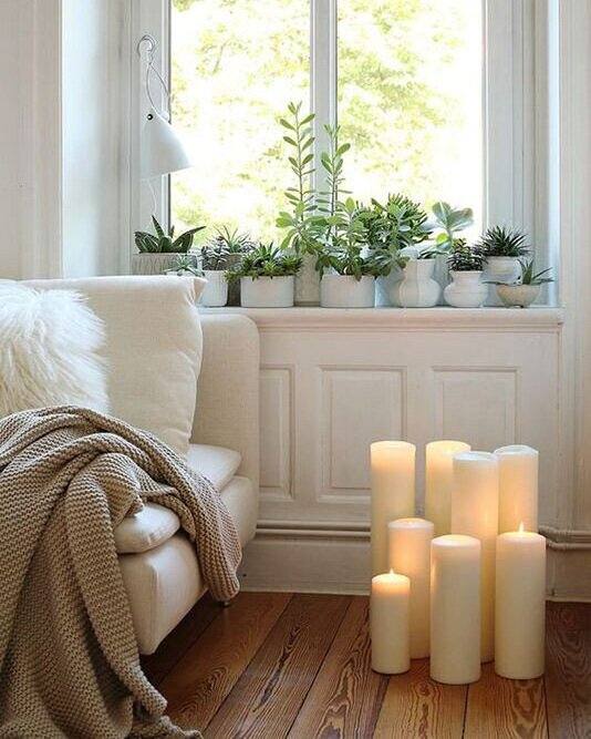 Hygge+Home+article.+Image+of+a+cosy+sofa+with+candles+beside+it.jpg