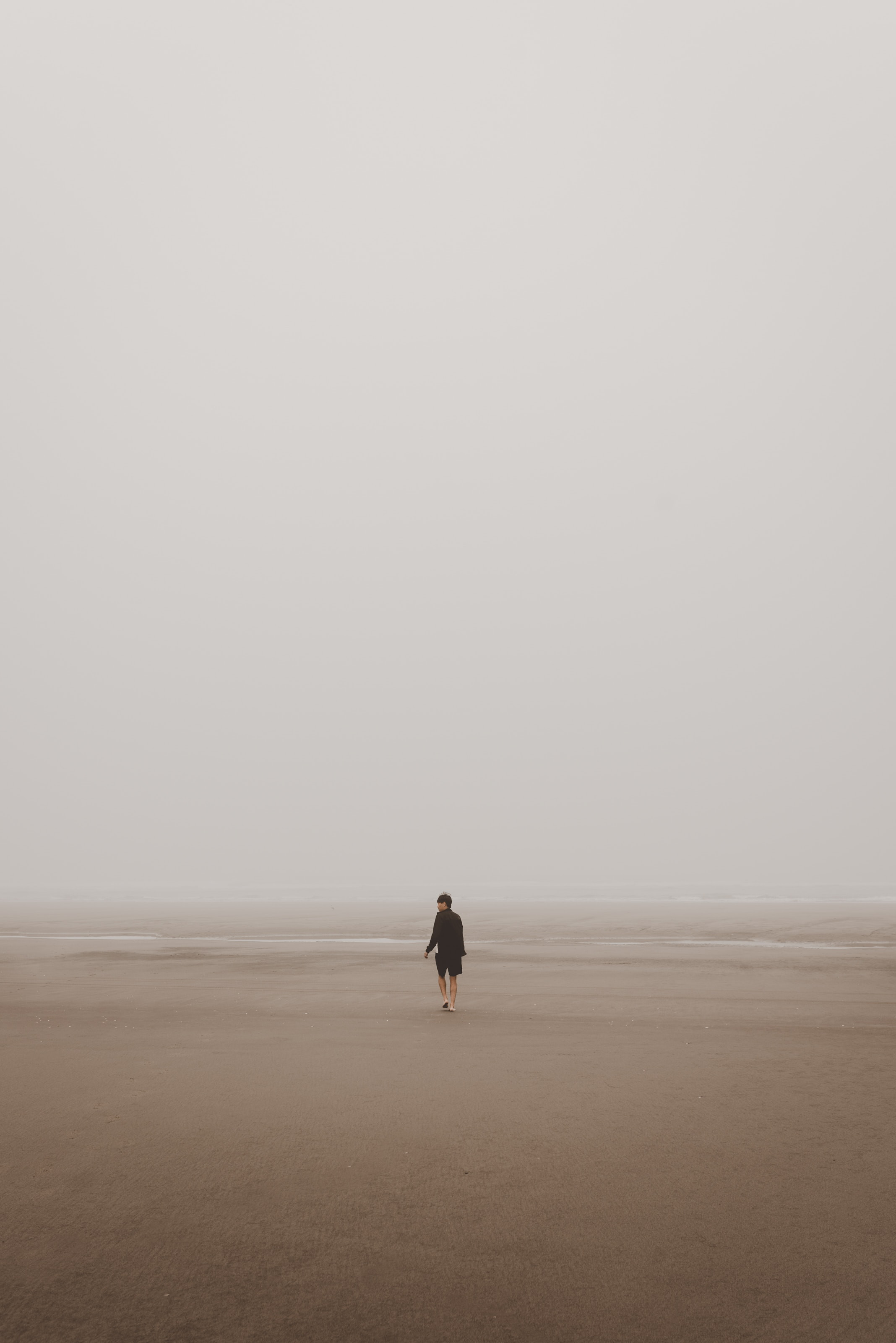 Minimalist lifestyle article. Image of person walking on a beach.jpg