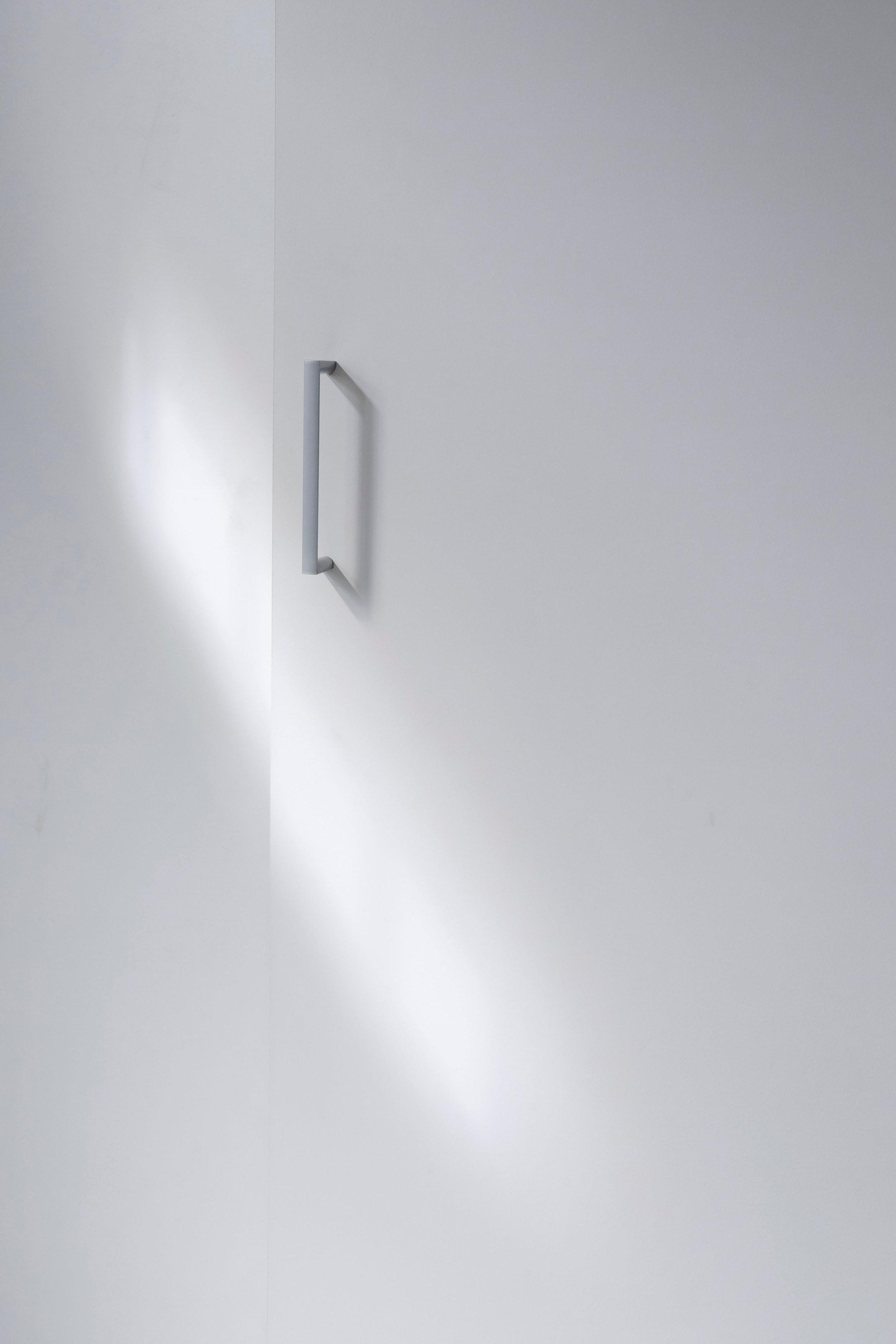 Minimalist lifestyle article. Image of white, minimalist handle.jpg