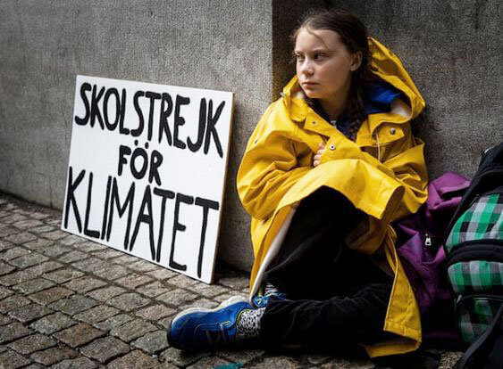 Greta Thunberg  striking against climate change in front of the Swedish parliament