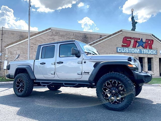 "Jeep Gladiator... 3"" Fabtech lift... 20"" Fuel Assault wheels on 35"" Ridge Grappler tires... NFab steps ...."