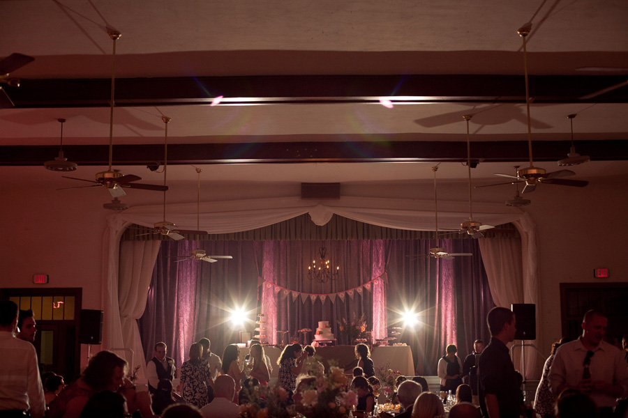Vintage wedding reception with view of front stage highlighted pink and violet