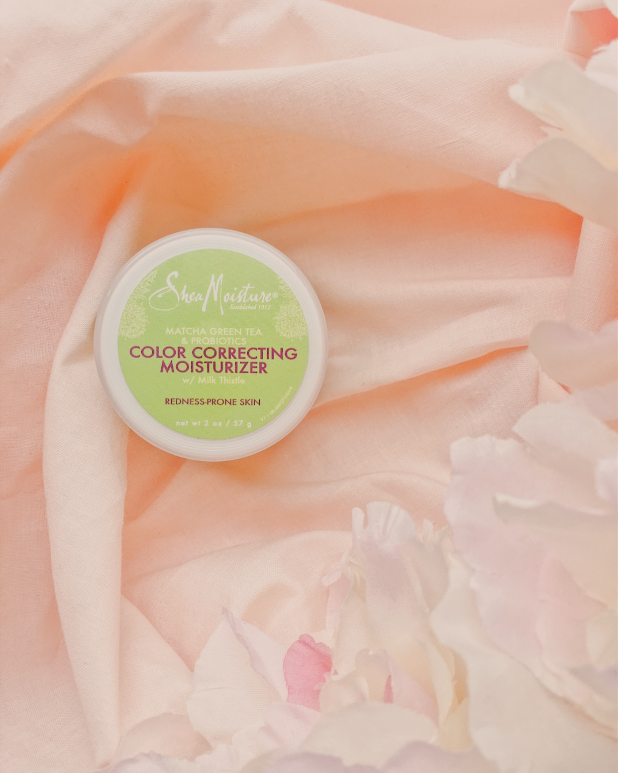 Sheamoisture color correcting moisturizer - For acne-prone/redness-prone skin, like mine, this moisturizer is a life saver!It contains antioxidant-rich matcha green tea to combat aging & acne combined with acne-fighting probiotics. The green pigments help to neutralize redness.I love the finish of this moisturizer because it's kind of tacky, so it makes for the perfect foundation base.