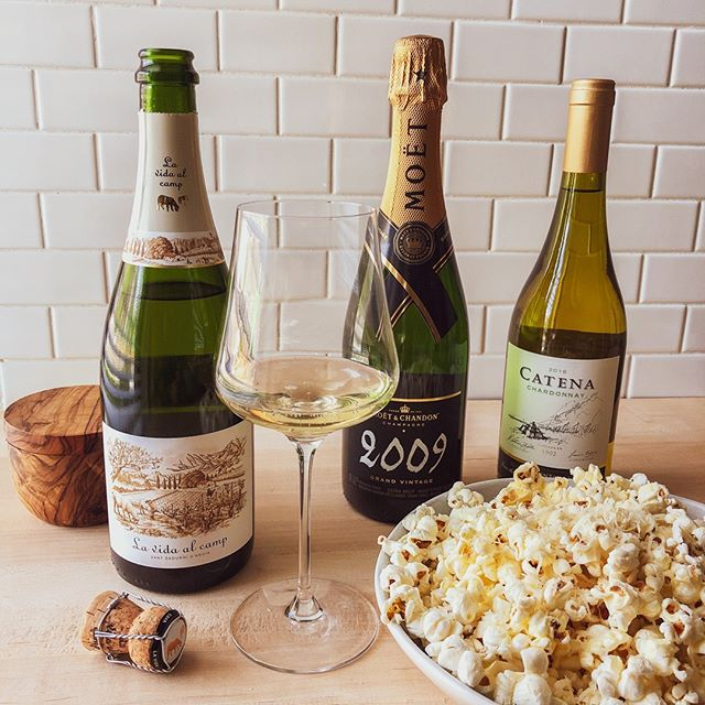 TGIF. Don't short weeks at work almost seem longer? Tonight seems perfect for a date night with a movie and a big bowl of buttery homemade popcorn with some parmesan sprinkled on top. 🍿🥂🎥 For this occasion we have two go-tos: bubbles and chardonnay.  . Catena from Mendoza, Argentina is an incredible value chardonnay. You do have like oak, but it is not overdone at all. Very balanced.  . If you are craving some bubbles and are in the mood to splurge, go straight to Champagne!  . If it doesn't seem like an occasion to pop the good stuff, Cava is a great alternative to get your bubbles fix. . You can read the full story on these wines, other recommended pairings for the occasion, and where to buy the wines with our #linkinbio . . #datenight #sparkling #wine #tgif #winetime