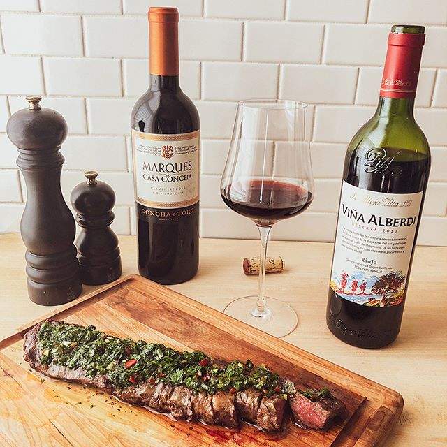 Deciding what to eat and drink this weekend? You have to try this combination: steak with chimichurri paired with herbal red wines. . ITHACA, NY: We picked both of these wines up at Northside Wine and Spirits. . Wine 1: One of the great value red wines: Chilean Carménère. It's really easy to drink but can stand up to the steak and its aromas really complement the chimichurri. . Wine 2: A classic style Rioja: its spicy herbal coconut flavors practically jump out of the glass and work really well with the bold flavors of the dish. . . #wine #foodie #foodandwine #instafood #foodstagram #winelover #winetime