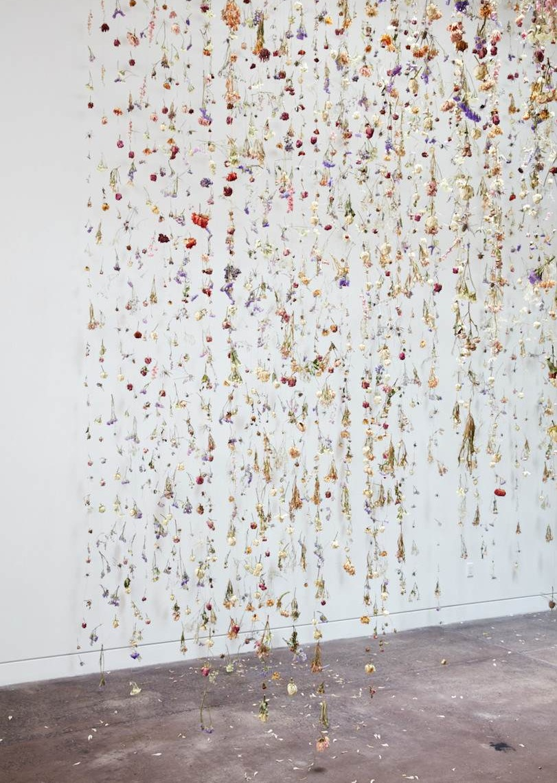 "Rebecca Louise Law: Painting on Air - Spring, 2018 (Interview)Standing amid a suspended cloud of thousands of flowers cascading from the ceiling, I realized that an installation by Rebecca Louise Law can be appreciated with eyes closed as well as open; physically looking at it is just one aspect of the experience. Recalling the wonder and innocence of a childhood spent outdoors, of lying in a field or playing in the garden, Law seeks to transform the physical senses evoked by being in nature into a work of art. ""I wanted to paint in the air,"" she explains, and ""I needed a material to help me do this."" Using the flower as sculptural material allows Law to create a space where the viewer can experience being inside the art, absorbing fragrances and textures, observing not only the beauty and colors of life, but the eventual decay, death, and preservation. [Read more]"