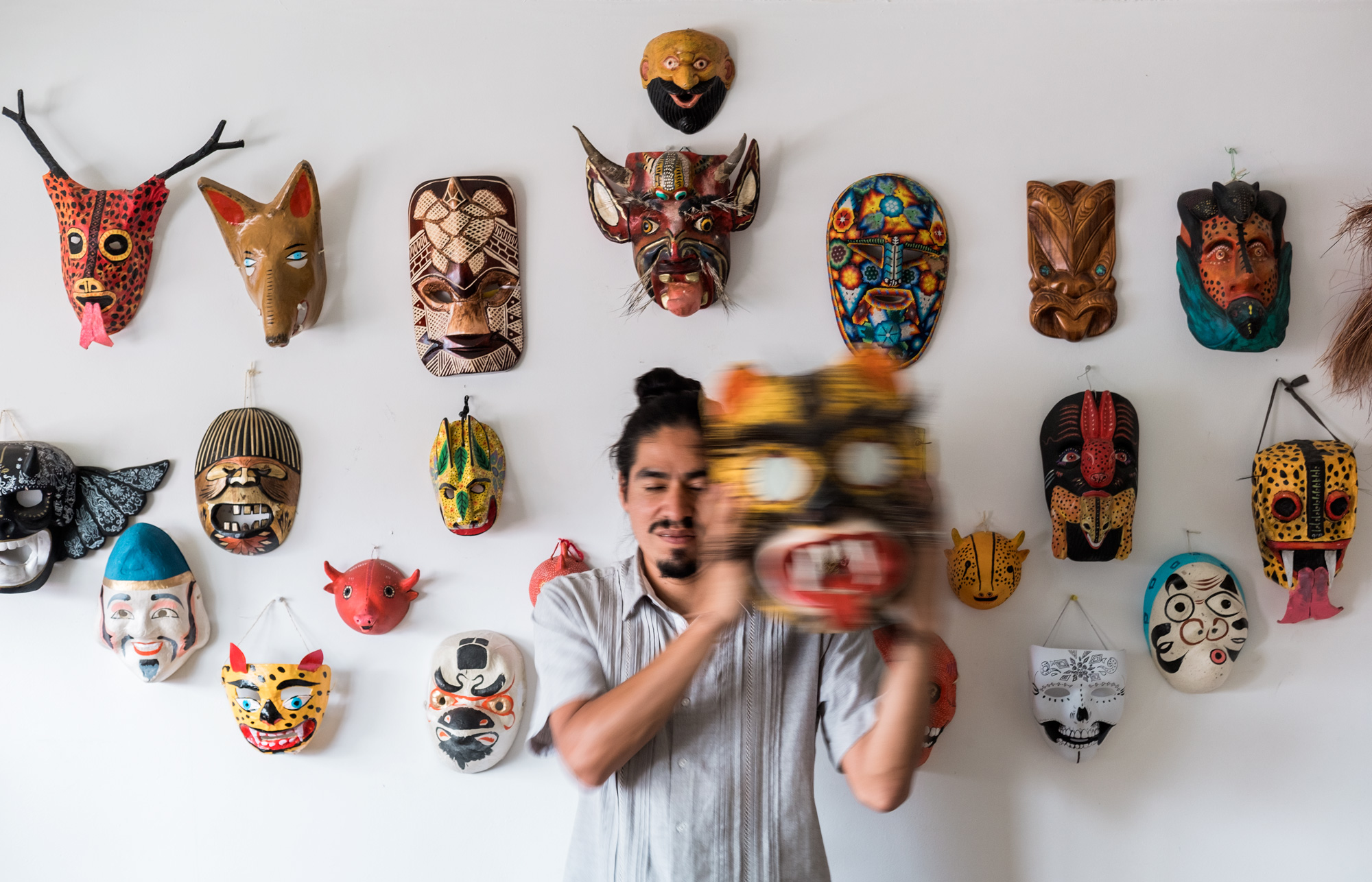 "Saner: Masked But No Stranger - November, 2017 (Interview and portrait)Saner has painted murals and participated in exhibitions everywhere from Morocco to Arkansas, combining contemporary Mexican and ancient Aztec and Mayan iconography with local history and folklore from around the world, as he tries to understand what divides us, and, hopefully unites us. Such travels have strengthened his roots and resolve to be part of a generation that learns from elders, teaches its youth, and creates positive change in a complicated world. ""Sometimes society builds walls,"" he tells me, ""but if we never break them down, we'll never have the opportunity to find out what kind of society we can have."" [Read more]"