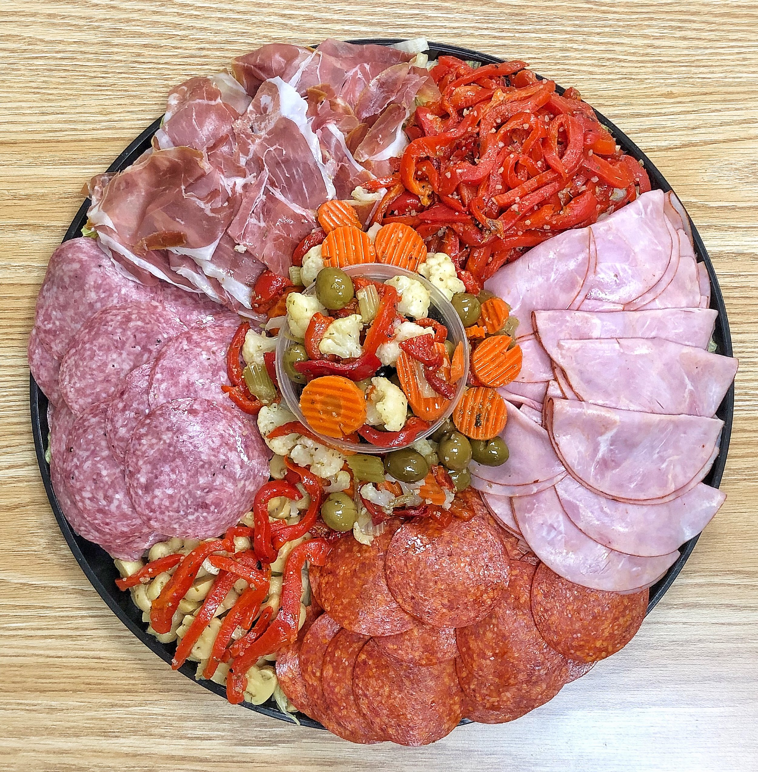 ANTIPASTO PLATTER - Meats: - Capicola Ham - Prosciutto di Parma - Genoa Salami - Mortadella - Coppa - Pepperoni - Turkey - Roast Beef - Corn BeefCheeses:- Imported Provolone - Imported Fontina - Parmigiano Reggiano - Swiss Cheese - Asiago Cheese - Fresh MozzarellaYou can customize your platter to whatever deli meats and cheeses we have in store!(Prices Vary)