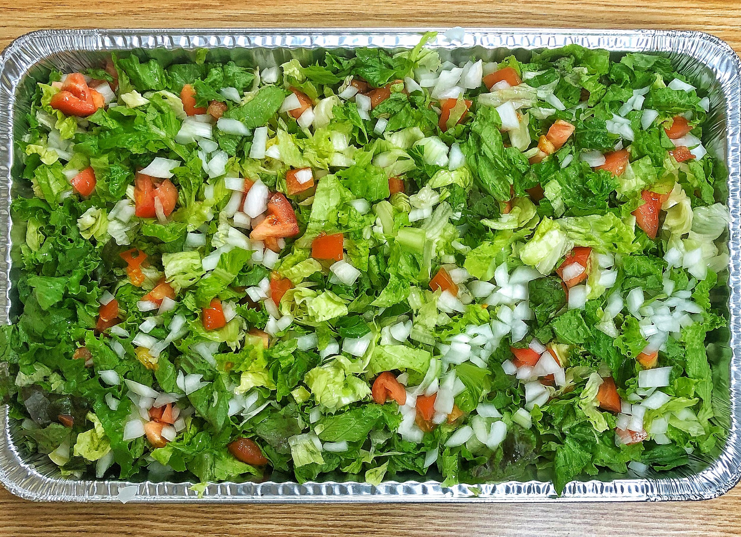 Garden Salad - Includes:- Iceburg Lettuce - Tomato - OnionCan Add- Any type of meat (Extra)- Olives - Any dressing or herbs