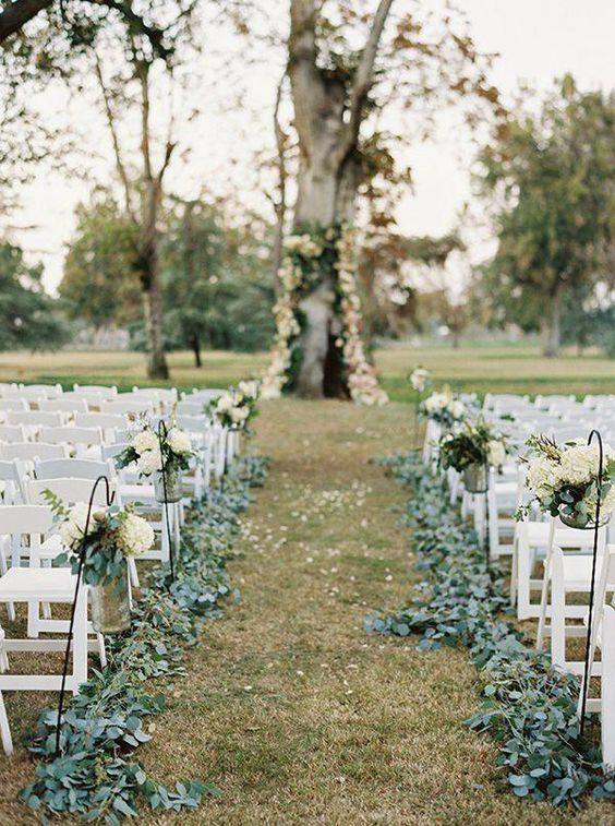 An outdoor wedding on a large lawn at the farm