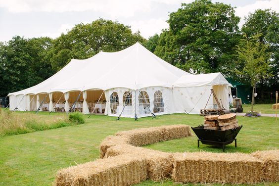 A massive white enclosed event tent for large events and chances of rain.