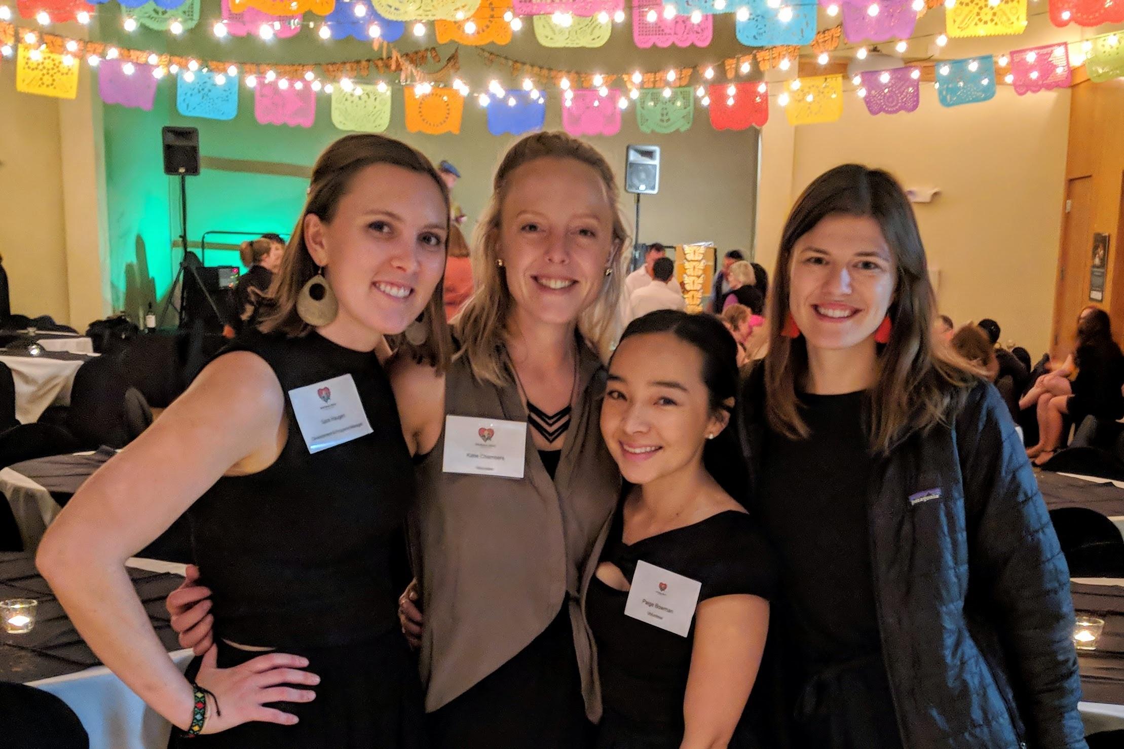 Sara Haugen, with volunteers Katie, Paige, and Zoë at the 2018 Fiesta