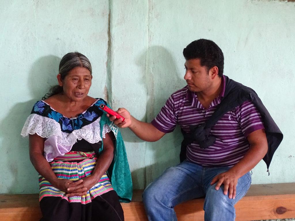 Radio staff member, Mariano Espinoza Guzmán, interviews a Tseltal woman for a  fotohistoria .