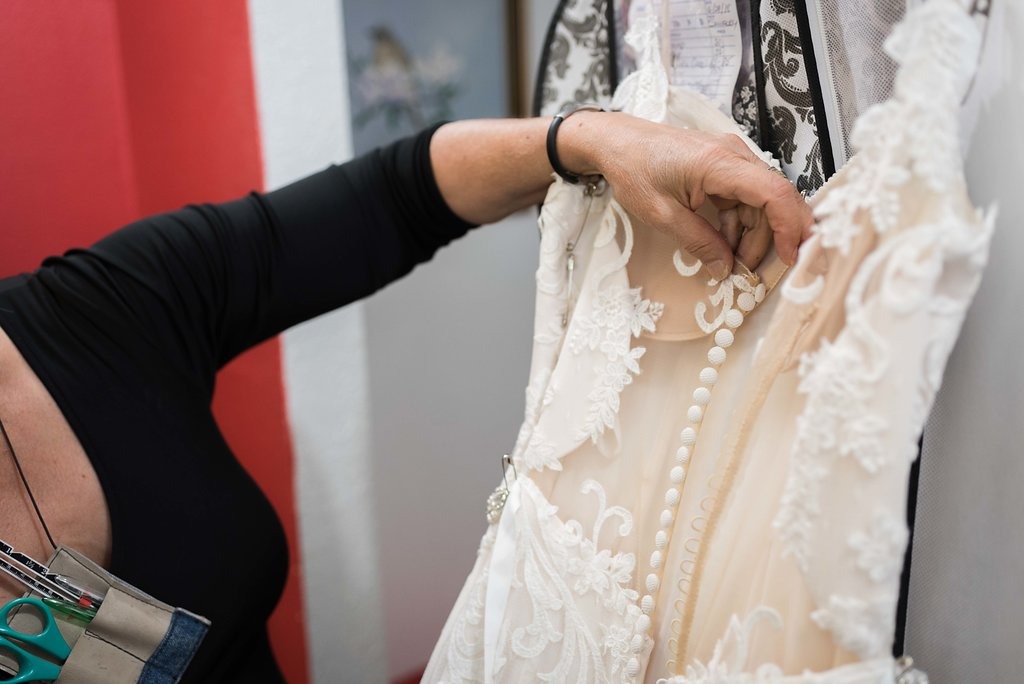 CONTACT SHIRLEY FOR BRIDAL APPOINTMENT - Not only do we fix bags, purses, pet items and hats, we can also alter your wedding dress.Call Shirley at 541-815-2434 for more information about our wedding dress alterations and hemming services.