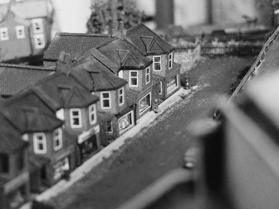 train journeys - We wanted to create a layout that echoed those journeys as a teenager, looking out onto the endless terraced houses from the train going into Victoria. We wanted to capture the gritty yet chic side to South London, where the high rise flats meet the Edwardian terraces. This layout includes a train too.
