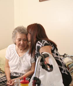caregiver kissing woman.jpg