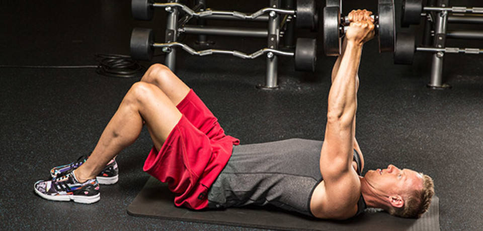 Triceps on the floor with dumbbells