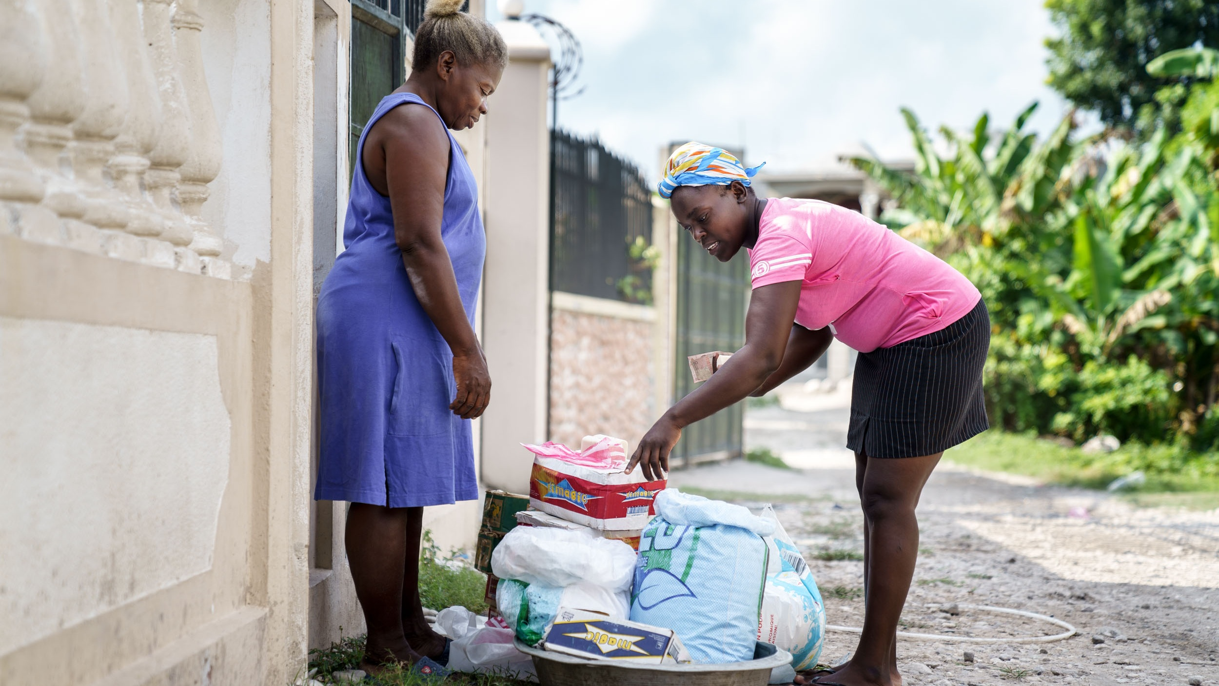 Parents who participate in our small business training program receive capital to start generating some income. Here, a mother is selling laundry supplies.   Photo by GBP Creative. © 2019 Shot In The Dark Media.