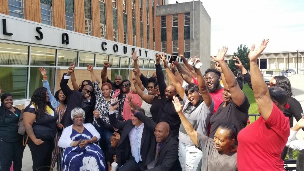 Family and friends celebrate outside the Tulsa County Courthouse after the decision.